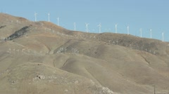 Hill covered by Green Energy Wind Mills - stock footage