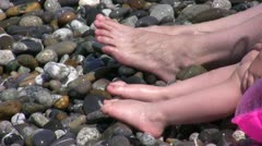 Sea wave washing foots of the legs Stock Footage