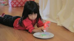 Girl Decorating Christmas Cookie With Red Icing Stock Footage