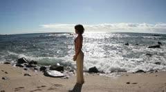 Yoga model amazing wild beach peaceful luxury Stock Footage