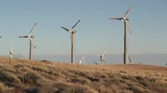 Close up from the top of the hill of wind mIlls Stock Footage