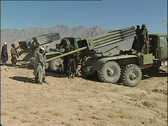 Stock Video Footage of Taliban artillerymen load rockets into launchers in Afghanistan desert.