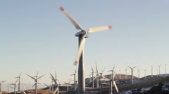 Close up of solo Wind Mill with many wind mills in the background. Stock Footage