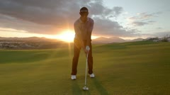 Pro golf swing amazing sunset Stock Footage