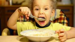 Boy eats soup itself Stock Footage