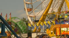midway rides at fairgrounds - Ferris Wheel and Zero Gravity - stock footage
