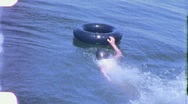 Boys Swims with Inner Tube Lake Summer Vacation 1960s Vintage Home Movie 2016 Stock Footage