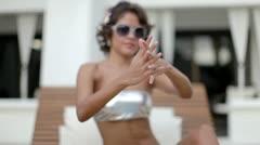 Beautiful bikini model dancing and posing by the pool Stock Footage
