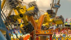 midway rides at fairgrounds - stock footage