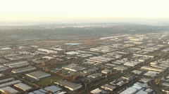 Aerial Time Lapse Passing Through Industrial District Stock Footage