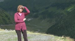 A young lady admire the beauty of the mountain - stock footage