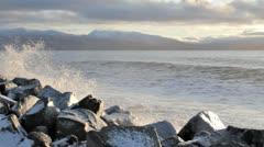 Big waves splashing on icy rocks Stock Footage