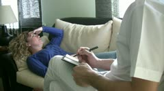 Psychiatrist listening and takes notes Stock Footage
