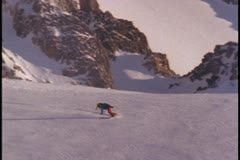 A snowboarder lays fresh tracks down a hill Stock Footage