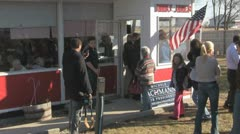 Stock Footage - Michele Bachmann Walking out of small town diner in Iowa Stock Footage