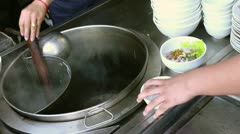 Traditional Asian food with soup and noodles prepared by chef Stock Footage