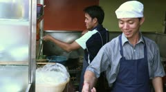 Teamwork with men cooking in Asian restaurant kitchen Stock Footage