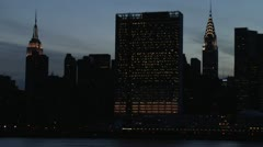 United Nations Building  Chrysler Building  Empire State Building at sunset Stock Footage