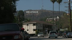 Hollywood sign, street and cars in foreground - stock footage