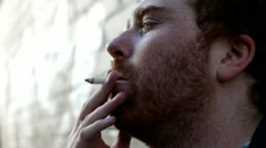 Male smoking cigarette Stock Footage