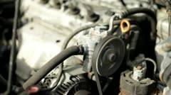 Belt in engine spinning pulley - stock footage