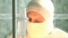 Drip during surgery, doctors are not in focus. sterile operating Stock Footage