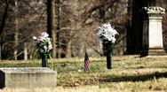 Grave with flowers and American flag Stock Footage