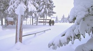 Stock Video Footage of Snowshoeing From the House to the Car in Winter 1