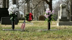 Flowers and wreath at graveyard Stock Footage
