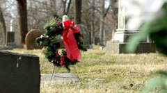 Gravestone with wreath on it Stock Footage