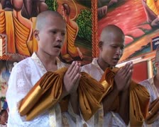 Ordination of young Thai monks in Thailand temple. - stock footage