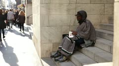 Homeless man sitting on steps in NYC Stock Footage