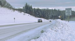 Winter Road Traffic on Snowy Highway Down Hill Stock Footage