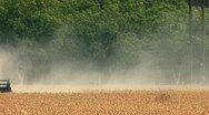 Stock Video Footage of Combine harvesting soybeans in agricultural field