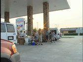 Stock Video Footage of La Place Gas Station: Refugees
