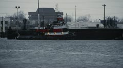 Tug boat in harbor- Norfolk, VA Stock Footage