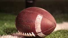 Moving shot around football on the line of scrimmage Stock Footage