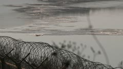 Fence at the border between north and south Korea - stock footage