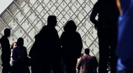 Stock Video Footage of People silhouetted in front of the Louver pyramid