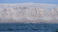 Icelandic Fishing Boat, Snowy Fjord foreground waves Stock Footage