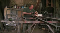 blacksmith doing his duty - stock footage