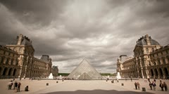 Cloudy timelapse of the Louvre in Paris Stock Footage