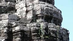 Ancient Temple (Angkor) - Tilt Down Viny Bayon Face Stock Footage