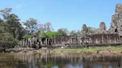Angkor Wat- Wider Shot (II) Slow pan along wall of Angkor Thom Stock Footage