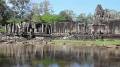 Angkor Wat- Wide Shot Slow pan along wall of Angkor Thom - stock footage