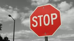 Stop sign. Grey timelapse clouds. Stock Footage