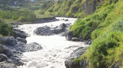 Panning over Pastaza river in Ecuador passing by the city of Banos Stock Footage