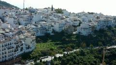 Hillside housing development in Frigiliana on the Costa Del Sol Stock Footage