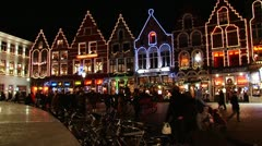 Bruges—Pedestrian on Market square at night5 Stock Footage