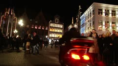 Bruges—Pedestrian on Market square at night4 Stock Footage